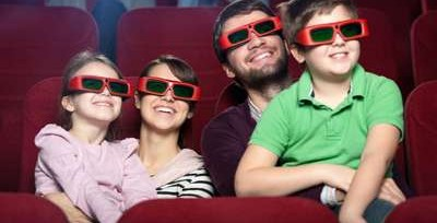 Smiling family in the movie theater