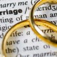 "Two wedding rings next to the word ""marriage"" on a english dictionary"